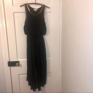 Black high low dress with gold chain detail.
